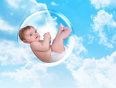 Baby Floating in Protection Bubble — Stock Photo