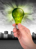 Hand Holding Green Energy Light Bulb — Stock Photo
