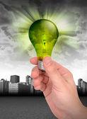 Hand Holding Green Energy Light Bulb — Stock Photo
