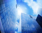 Bright Blue City Buildings with Clouds — Stock Photo