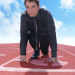Business Man On A Track With Clouds — Stock Photo