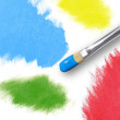 Colorful Rainbow Paint Splatters and Paintbrush — Stock Photo