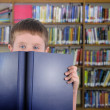 Boy with Blue Book in Library — Stock Photo