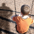 Stock Photo: Scared Boy on Swingset with Bully Defense