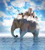 大象携带与云背上的城市 — 图库照片