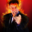 Angry Fired Boss Pointing with Flames - Stock Photo
