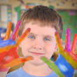 Art School Child with Painted Hands - Stock Photo