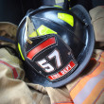 Firefighter hat helmet on Jacket — Stock Photo #18785157