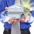 Real Estate House in Hands - Stock Photo
