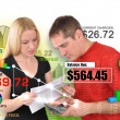 Finance Couple Reviewing Bills on White — Stockfoto #22463215