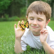 Little Boy Catching Spring Butterfly Outside — Stock Photo #22940344
