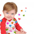 Cute Little Baby with Love Hearts on White - Stock Photo