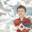 Stock Photo: Superhero Boy Child with Open Shirt and Clouds