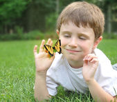 Little Boy Catching Spring Butterfly Outside — Stock Photo