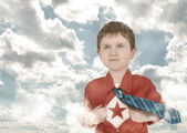 Superhero Boy Child with Open Shirt and Clouds — Stock Photo