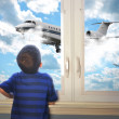 Boy Looking at Flying Airplane in Room — Stock Photo