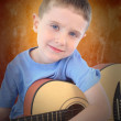 Young Boy Holding Acoustic Guitar — Stock Photo