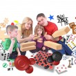 Happy Family Playing Games Together on White — Stock Photo #26262391