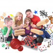 Happy Family Playing Games Together on White — Stock Photo
