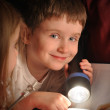 Boy Reading Book at Night with Flashlight — Stock Photo
