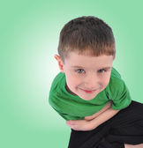 Happy Boy Looking Up on Green Background — Stock Photo