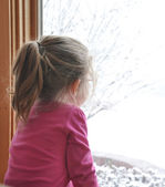 Child Looking Out Winter Window — Stock Photo