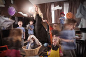 Funny Housewife Cleanning House with Children — Stock Photo