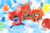 Little Superhero Kids Flying in the Sky — Stock Photo