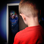 Scary Monster Clown in Boys Closet — Stock Photo