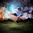 Space Boy in Box Touching Glowing Star — Stock Photo