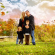 Happy Fall Family Outside with Leaves — Stock Photo