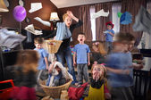Tired Housewife Cleanning House with Children — Stock Photo