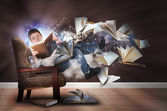 Imagination Boy Reading Books in Chair — Stock Photo