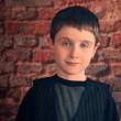 Photo Portrait of Young Boy with Brick Wall — Stock Photo #45919309
