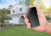 Smart Phone Checking Home with Blank Screen — Stock Photo