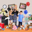 Stressed Mother with Wild Children in Messy House — Stock Photo #49893875