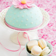Macarons and a decorated cake — Stock Photo