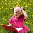 Girl with toy laptop — Stock Photo