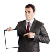 Businessman pointing finger at blank clipboard — Stock Photo