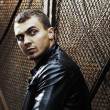 Brutal young sexual man in a leather jacket — Stockfoto