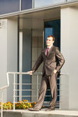Businessman standing on the threshold — Stock Photo