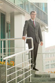 Businessman standing on the threshold — Stock Photo