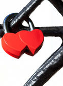 Red lock in the form of two hearts — Stock Photo
