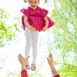 Father tossing up his daughter laughing — Stock Photo
