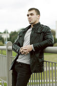 Brutal young man in a leather jacket — Stock Photo
