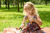 Little girl making a bouquet — Stock Photo