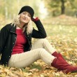 Stock Photo: Womsitting on ground in park