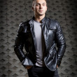 Brutal young man in a leather jacket — Stock Photo #13842944