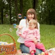 Mother with baby in the park — Stock Photo #13870852