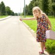 Girl on the road — Stock Photo